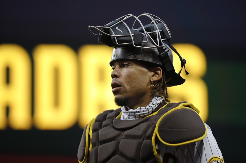 The Padres' Luis Campusano walks to the dugout