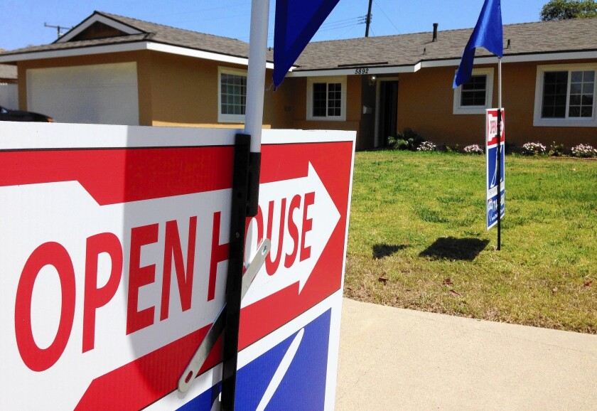In Orange County, the region's most expensive market, about one-third of sellers have had to cut prices, according to real estate firm Redfin. Above, a home for sale in Huntington Beach.
