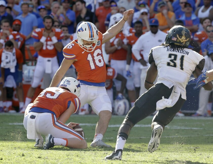 Florida place kicker Austin Hardin (16) kicks a 43-yard field goal as Vanderbilt cornerback Tre Herndon (31) tries for the block during the second half of an NCAA college football game, Saturday, Nov. 7, 2015, in Gainesville, Fla. Florida won 9-7. (AP Photo/John Raoux)