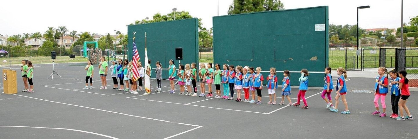 Girl Scouts lead the Pledge of Allegiance