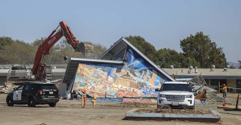 Despite protests, construction crews tore down building with artwork by muralist Salvador Roberto Torres.