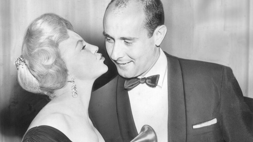 """#GrammysSoDad? Peggy Lee, left, presents the album of the year Grammy to Henry Mancini for """"Peter Gunn"""" at the first-ever award ceremony at the Beverly Hilton in 1959."""