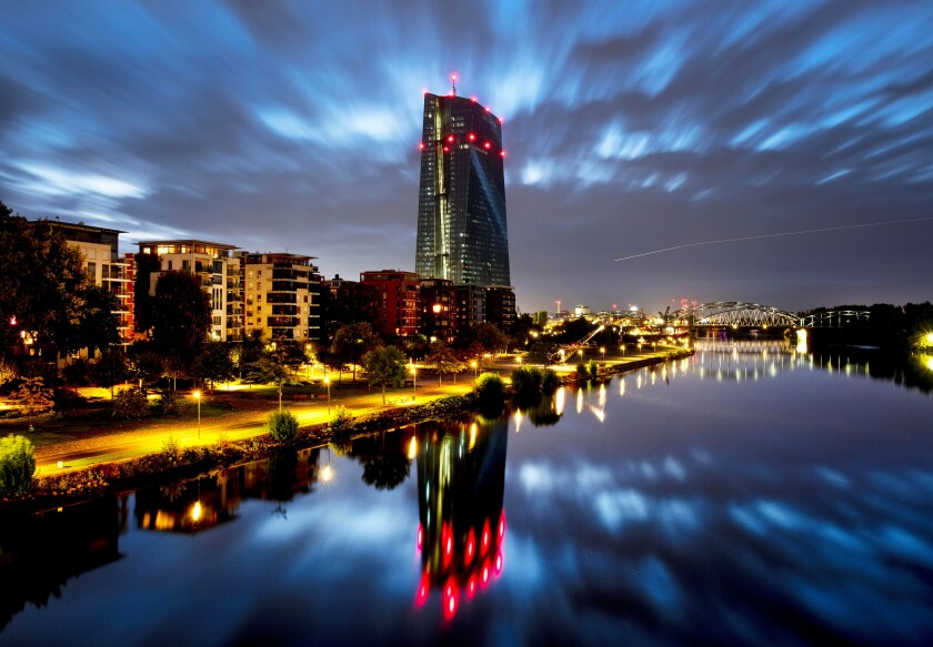 Clouds pass over the European Central Bank building, center, in Frankfurt, Germany, early Saturday, Sept. 28, 2019. (AP Photo/Michael Probst)