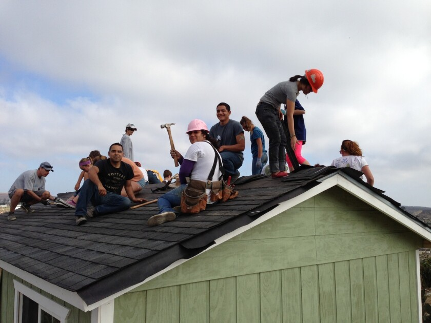 Volunteers at work on a Casas de Luz home build in Tijuana.