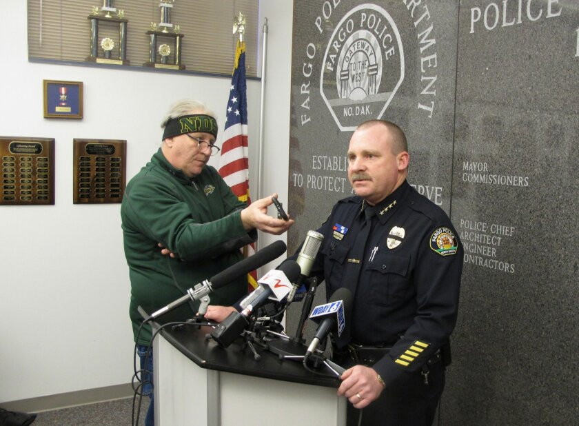 Fargo Police Chief Dave Todd appears at a news conference at police headquarters in Fargo, N .D., on Thursday, Feb. 11, 2016to talk about a shooting that left one of his officers mortally wounded and a suspect dead. Todd says Officer Jason Moszer, a six-year veteran of the force, is not expected to
