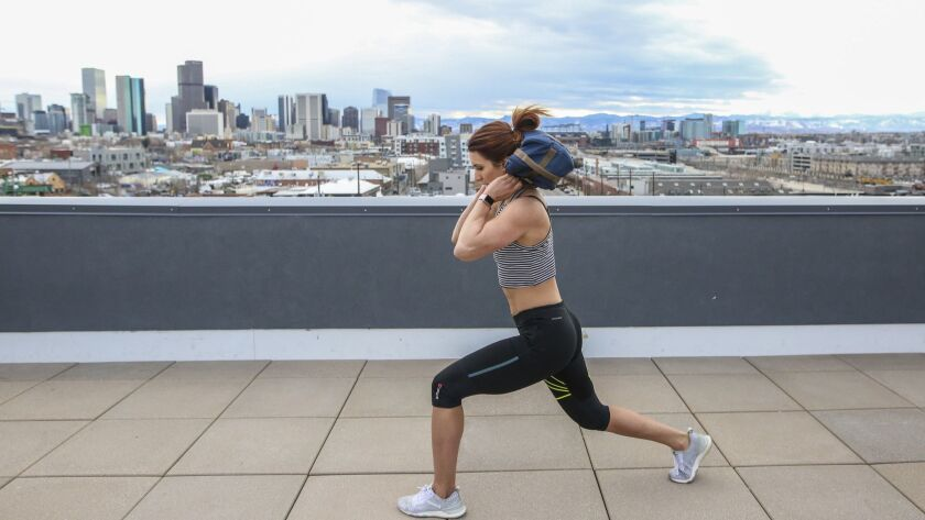 Emily Schromm trains on a rooftop with her EmPack Nomad.