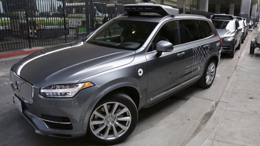 An Uber self-driving car heads out for a test drive in December.