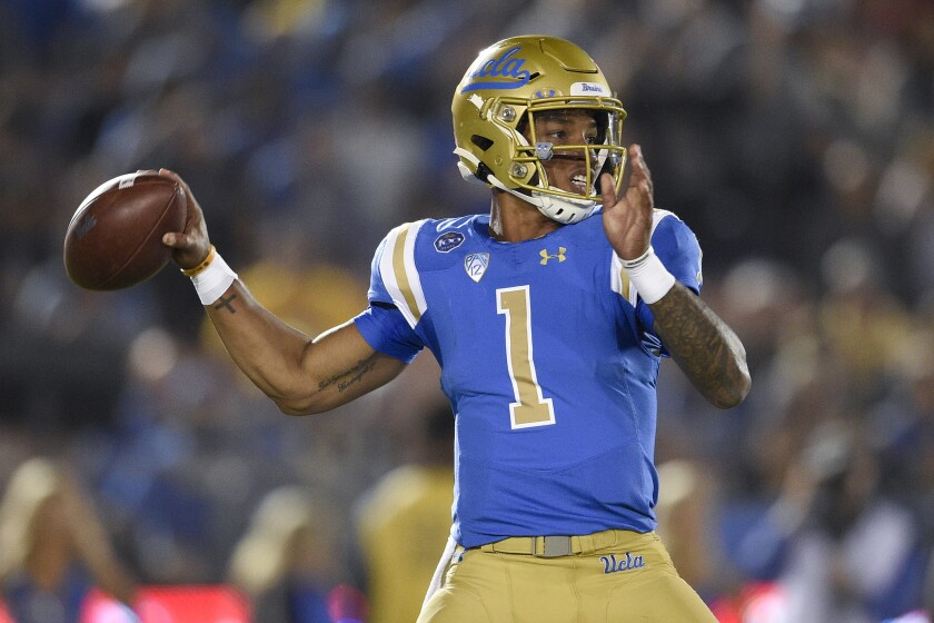 UCLA quarterback Dorian Thompson-Robinson throws a pass against Colorado on Nov. 2, 2019.