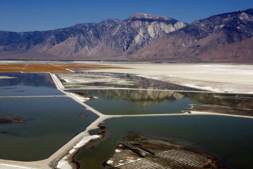 Owens Lake, once a large inland sea, is now a a vast patchwork of alkali flats, gravel beds and green and crimson sheets of ankle-deep water.