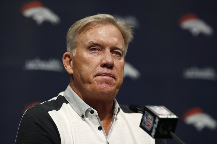 FILE - In this June 17, 2019 file photo John Elway, general manager of the Denver Broncos, speaks during a news conference at the NFL team's headquarters in Englewood, Colo. Broncos general manager John Elway hasn't been able to find a worthy successor to Peyton Manning in the four years since his retirement. Elway declared last summer he finally felt good about his QB situation after trading for Joe Flacco and drafting Drew Lock. But Flacco is on IR with a neck injury and Lock has been on IR all year with a sprained thumb and won't return to practice for a couple of more weeks. (AP Photo/David Zalubowski, File)