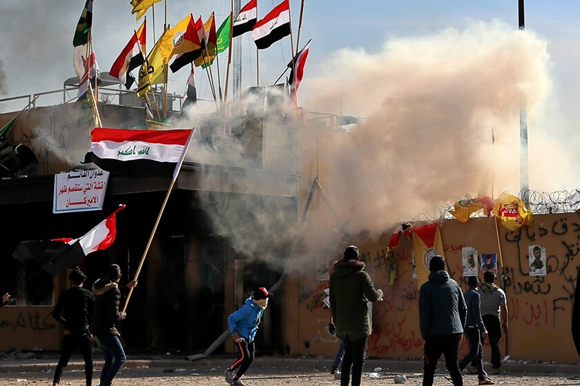 Protesters at the U.S. Embassy compound in Iraq set a fire on the roof of a reception area Wednesday.