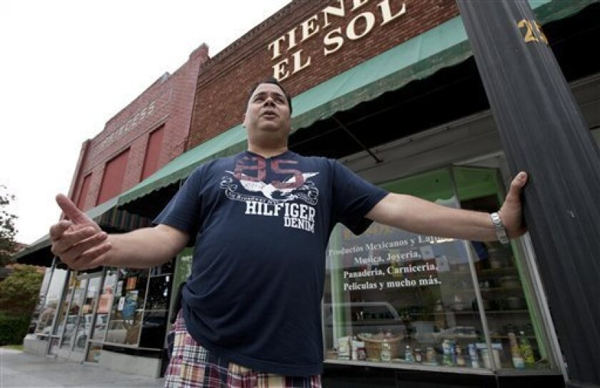 Jose Contreras stands outside his closed store and restaurant in Albertville, Ala., Wednesday, Oct. 12, 2011. Dozens of businesses across the state shut down as Hispanics took a day off from work to protest against Alabama's tough new immigration law. (AP Photo/Dave Martin)