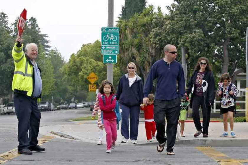 Crossing guard helps parents and children