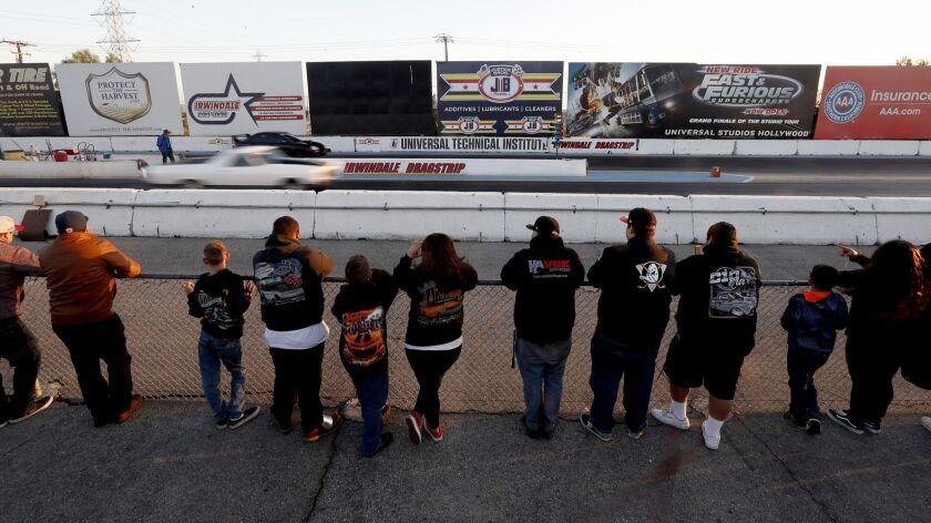IRWINDALE, CALIF. - APR. 19, 2018. Spectatros watch drag races at the Irwindale Speedway in Irwinda