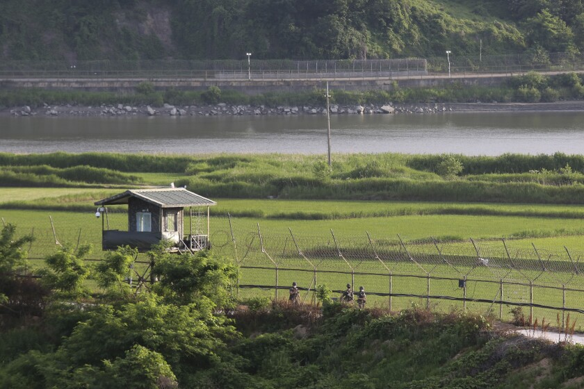 South Korean army soldiers patrol along the barbed-wire fence in Paju, South Korea, near the border with North Korea, Monday, June 15, 2020. South Korean President Moon Jae-in called on North Korea to stop raising animosities and return to talks, saying Monday the rivals must not reverse the peace deals that he and North Korean leader Kim Jong Un reached during 2018 summits. (AP Photo/Ahn Young-joon)