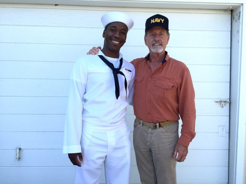 Vidal Woody (left) is now 20 and has served in the U.S. Navy for more than a year. He is pictured with former Del Mar Mayor Richard Earnest (right).