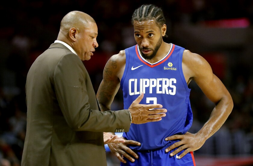 Coach Doc Rivers and Kawhi Leonard talk during a break in a Clippers game earlier this season.