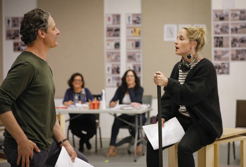 """Actors Peter Rini and Morgan Hallett work through a scene at an Old Globe rehearsal of """"They Promised Her the Moon,"""" as playwright Laurel Ollstein and director Giovanna Sardelli look on."""