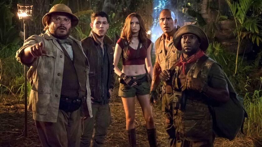 "Jack Black, from left, Nick Jonas, Karen Gillan, Dwayne Johnson and Kevin Hart in ""Jumanji: Welcome to the Jungle."""