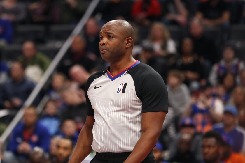 FILE - In this Feb. 8, 2020 file photo, Referee Courtney Kirkland watches during the first half of an NBA basketball game between the Detroit Pistons and the New York Knicks in Detroit. The only instances of NBA referees Kirkland, Tom Washington, Tony Brown all officiating together are some offseason pro-am games in Atlanta, the city they all call home. That will change Sunday, March 7, 2021 The trio was chosen as the officiating crew for this year's All-Star Game. (AP Photo/Carlos Osorio, File)