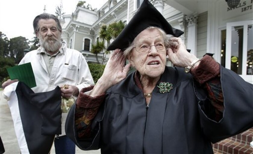 Hazel Soares, 94, right, gets ready before the start of commencement exercises at Mills College, as her son Matthew Soares, 59, looks on in Oakland, Calif., Saturday, May 15, 2010. Hazel received a  degree of Bachelor of Arts in Art History. (AP Photo/Tony Avelar)