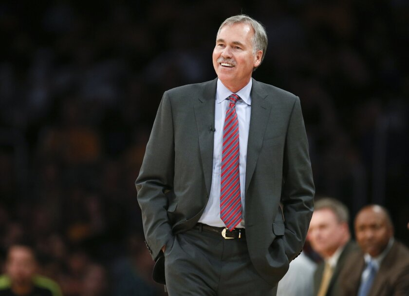 "FILE - In this March 9, 2014, file photo, then-Los Angeles Lakers coach Mike D'Antoni walks the sideline during the NBA basketball team's gane against the Oklahoma City Thunder in Los Angeles. D'Antoni is headed to Houston to try his ""Seven Seconds or Less"" offense with James Harden, one of the NBA"