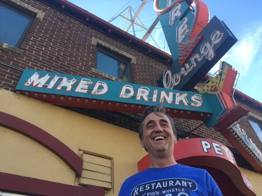 DENVER - COLO: Jonny Barber, 48, on his beloved Colfax Avenue.