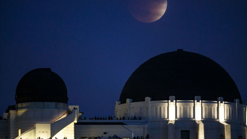Moonrise over the Griffith Observatory.