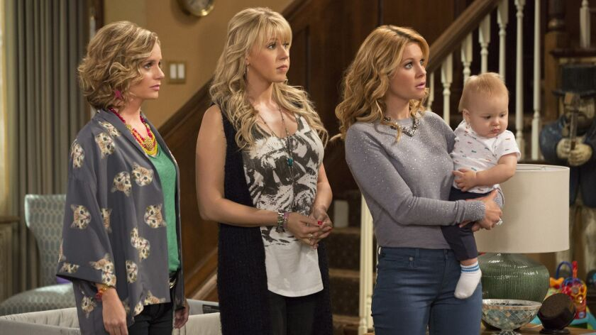 This image released by Netflix shows, from left, Andrea Barber, Jodie Sweetin, and Candace Cameron B