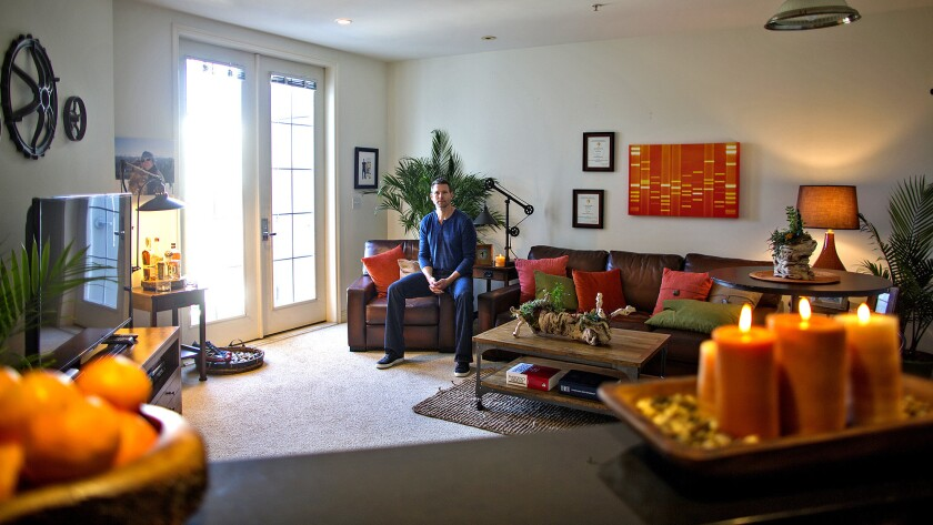"""""""The Doctors"""" host, a Nashville resident who commutes between TV seasons, said his second home — a top-floor two-bedroom in Hancock Park — is comfortable and convenient. He spends most of his time there in the living room."""
