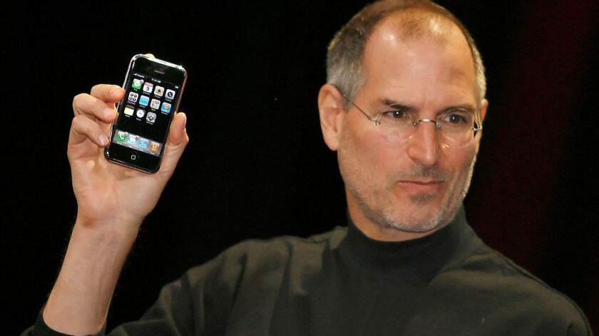 Steve Jobs debuted the first iPhone at the Macworld Conference in San Francisco on Jan. 9, 2007.