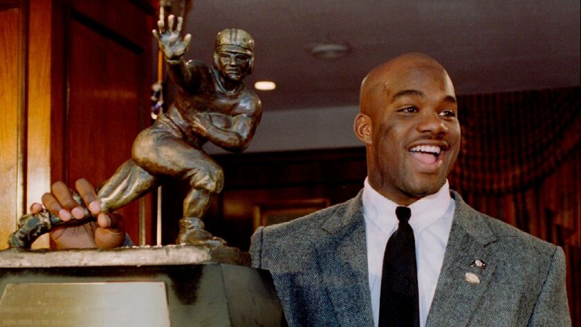 Colorado tailback Rashaan Salaam, stands with the Heisman Trophy, College Football's highest award, after being named the outstanding college football player of 1994 at the Downtown Athletic Club in New York, U.S. on December 10, 1994.