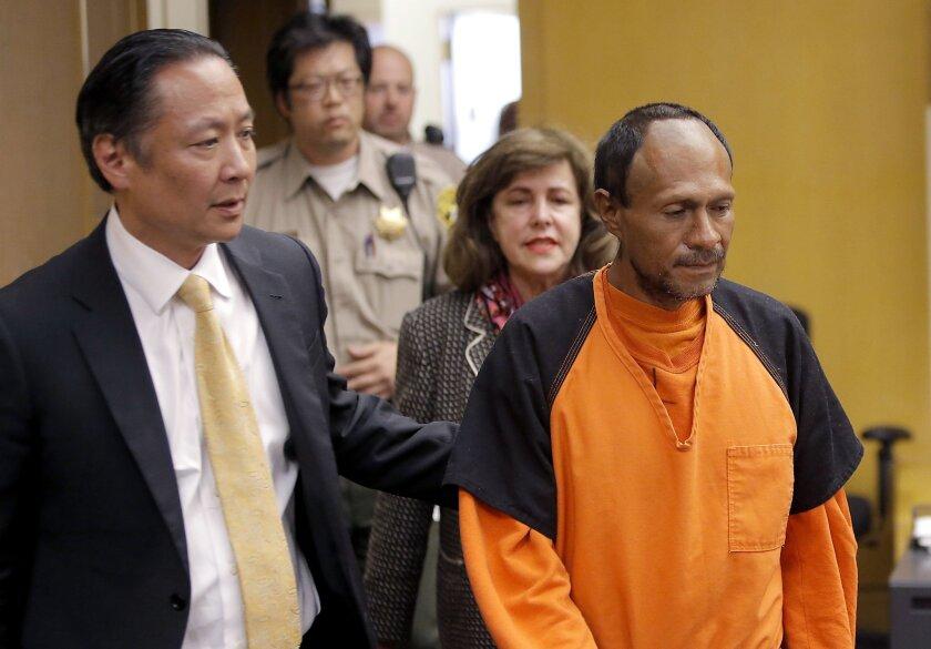 San Francisco shooting suspect Juan Francisco Lopez-Sanchez as he was led into court July 7. At left is San Francisco Public Defender Jeff Adachi.