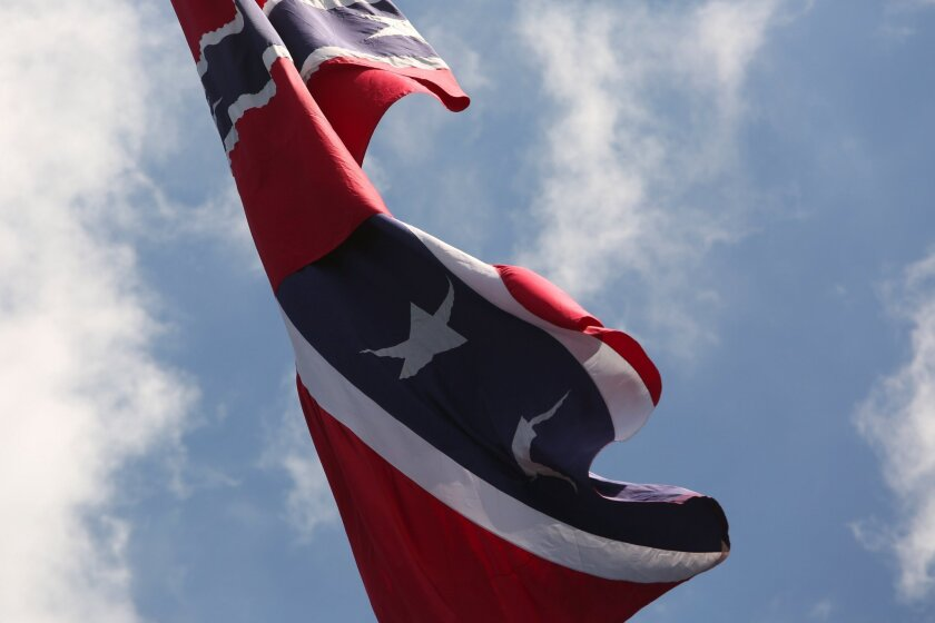 A flag waves in the wind in Florida as South Carolina lawmakers debate taking down the Confederate battle flag flying in front of the Statehouse.
