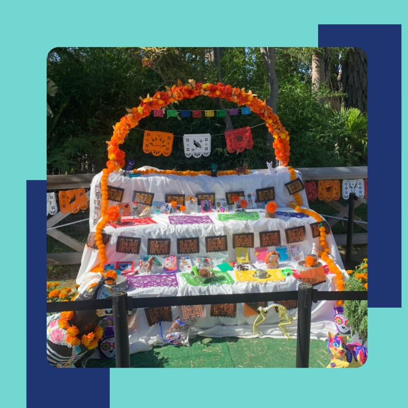 Picture of an altar decorated with paper flowers and flags