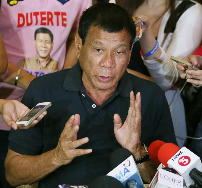 """FILE - In this April 29, 2016 file photo, presidential candidate Rodrigo Duterte answers questions from the media in Manila, Philippines. International Criminal Court judges on Wednesday Sept. 15, 2021, authorized an investigation into the Philippines' deadly """"war on drugs"""" campaign, saying the crackdown """"cannot be seen as a legitimate law enforcement operation."""" (AP Photo/Bullit Marquez, File)"""