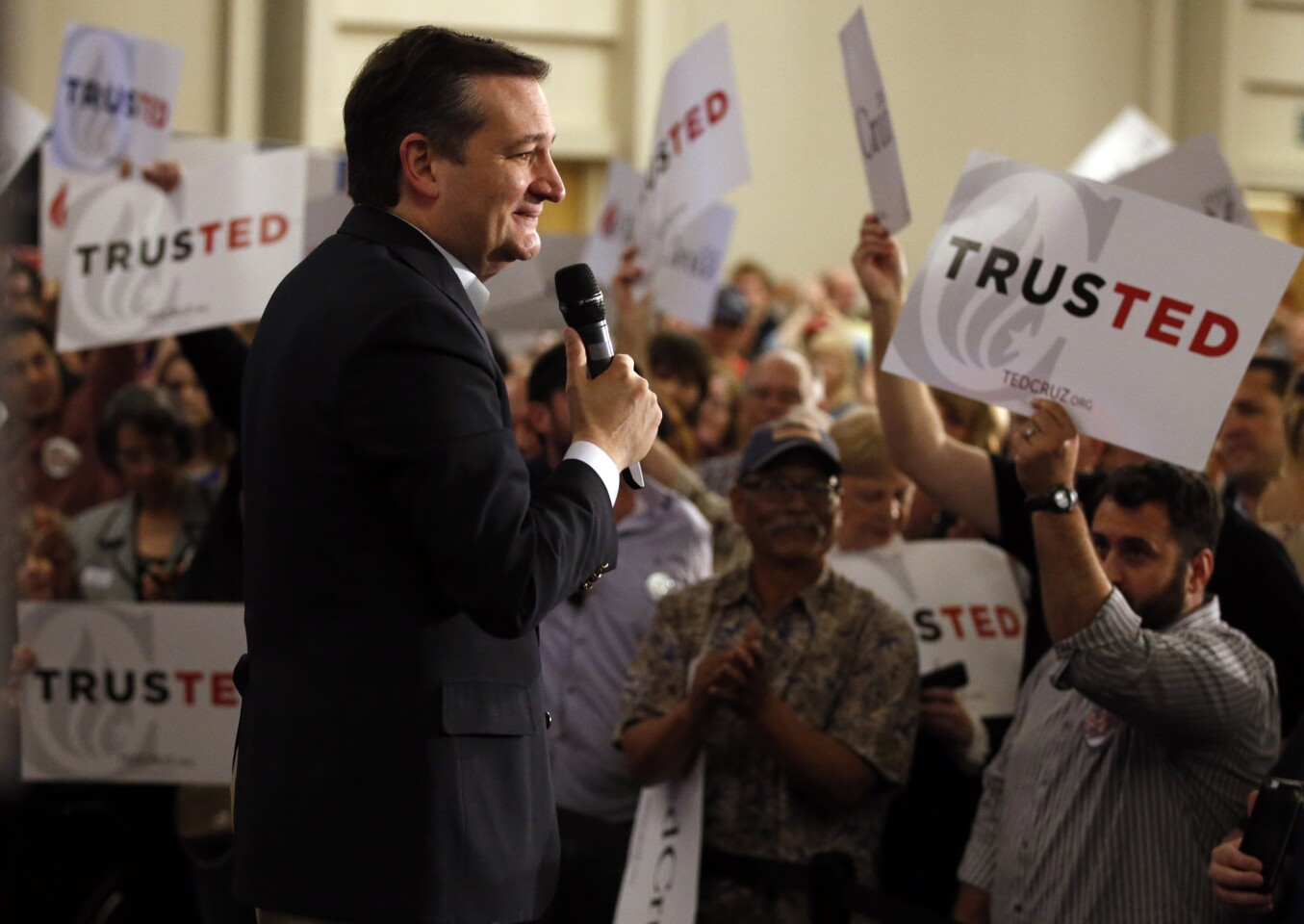 Republican presidential candidate Ted Cruz smiles at the enthusiastic crowd of supporters during his rally at the Hotel Irvine on April 11.