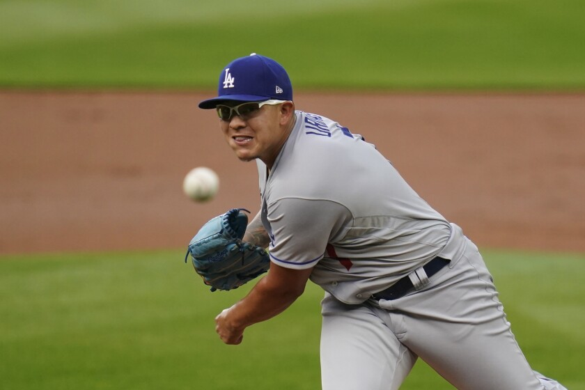 Dodgers pitcher Julio Urias throws against the Seattle Mariners.