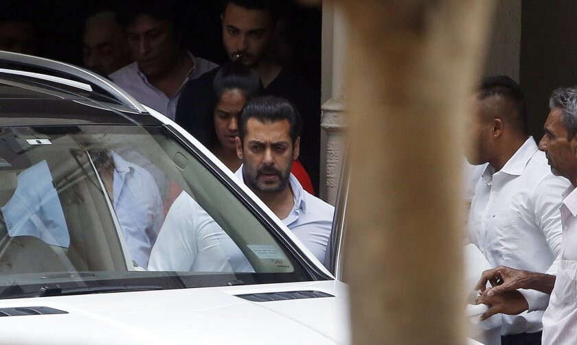 Bollywood actor Salman Khan, center, leaves his residence to travel to court in Mumbai, India, on May 8.