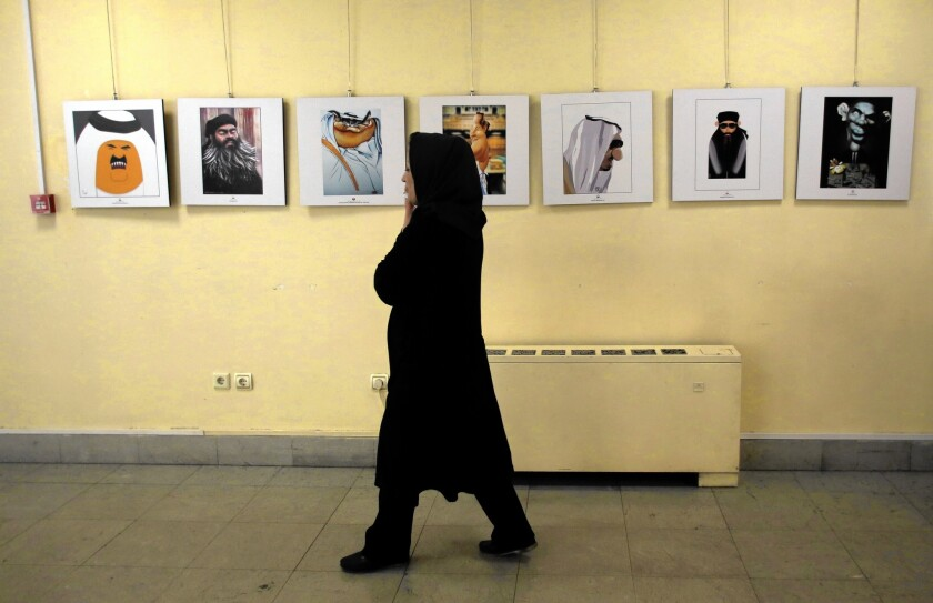 Cartoons are displayed as part of the Daesh International Cartoon and Caricature Contest in Tehran.