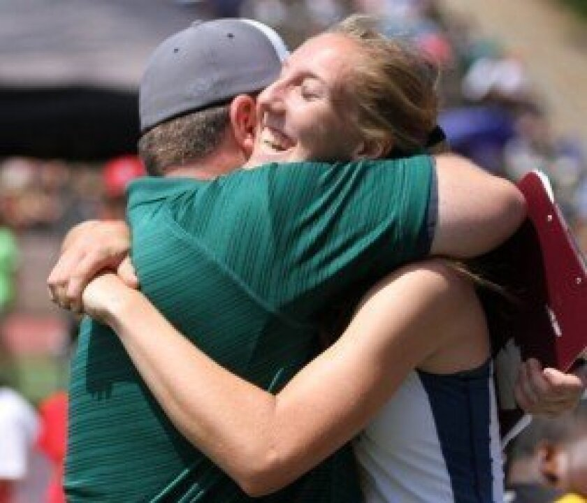 Del Norte High's Caitlin Cole hugs Nighthawks coach Chris Ruff after capturing the CIF San Diego Section triple jump crown on Saturday. Photo by Sherri Cortez