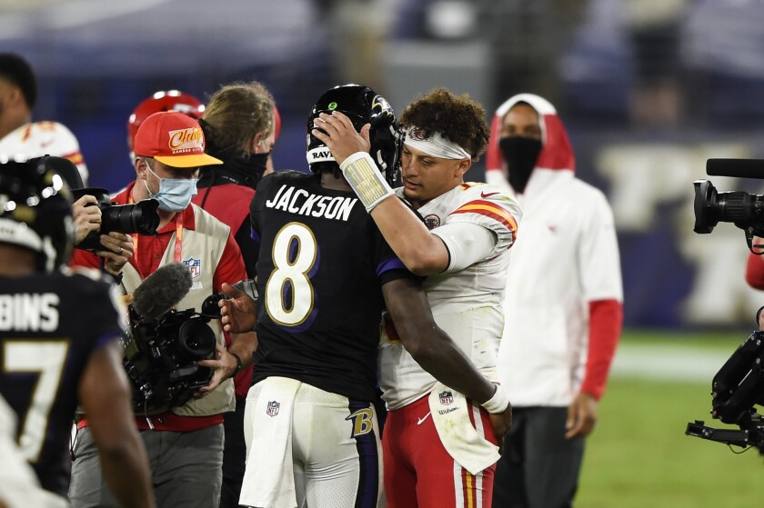 Baltimore Ravens quarterback Lamar Jackson (8) and Kansas City Chiefs quarterback Patrick Mahomes (15) embrace after an NFL football game, Monday, Sept. 28, 2020, in Baltimore. The Chiefs won 34-20. (AP Photo/Gail Burton)