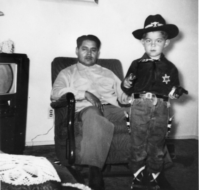 "A photograph of Doroteo Lucero (left) and son, Luis, at home in Norwalk, circa 1955 featured in Carolyn Kozo Cole's project, ""Shades of L.A."""