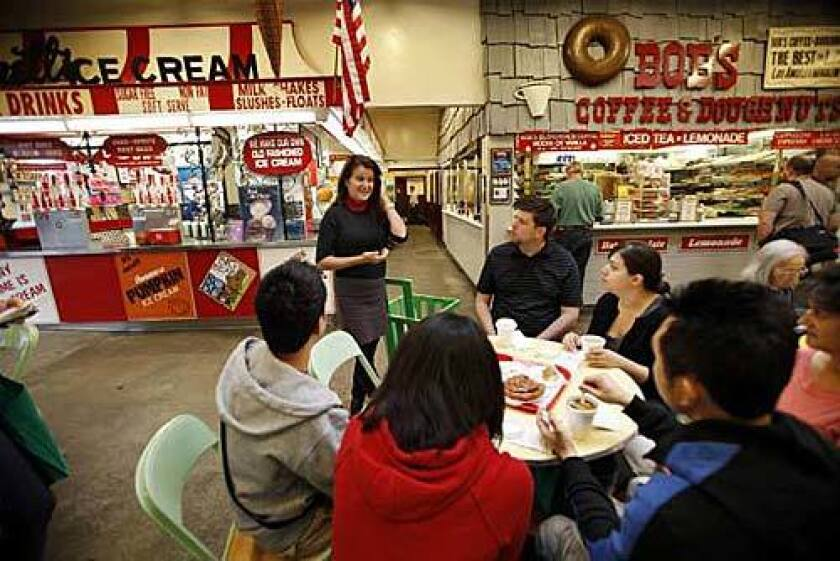 Melting Pot Food Tours co-founder Diane Scalia leads a group through the Original Farmers Market in L.A.