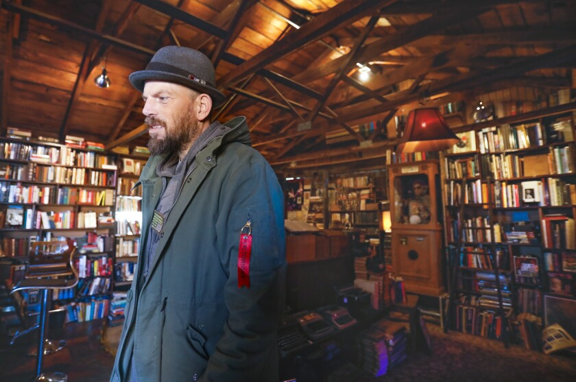 Sean Christopher, the owner of Lhooq Books, a funky vintage bookstore in Carlsbad Village. He recently received a 60-day eviction notice for both the shop and the adjoining house where he has raised his son, alone. He's hoping to achieve a stay of eviction on the property long enough to sell off his book inventory and find a new space without going bankrupt and ending up homeless with his son. Photographed October 11, 2019, in Carlsbad, California.