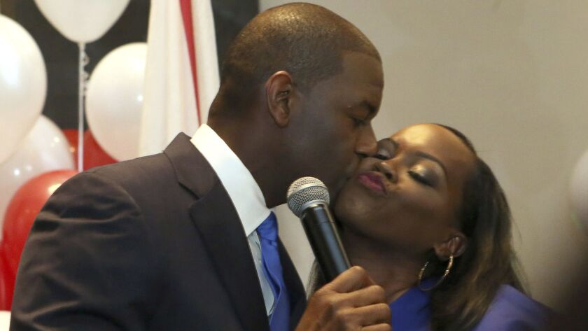 Andrew Gillum kisses wife, R. Jai Gillum as he addresses his supporters after winning the Democrat p