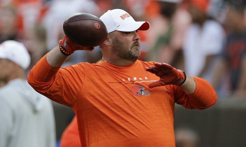 Cleveland Browns coach Freddie Kitchens throws a football.