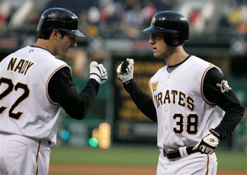 Pittsburgh Pirates' Jason Bay (38) is greeted at home plate by Pirates' Xavier Nady, left, after hitting a two-run home run off Milwaukee Brewers pitcher Dave Bush in the fourth inning of a baseball game in Pittsburgh Thursday, May 22, 2008. (AP Photo/Gene J. Puskar)