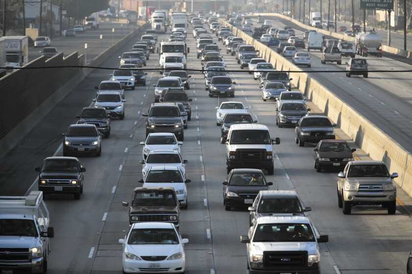 Traffic on the 5 Freeway in Los Angeles; a bill aimed at reducing greenhouse gas emissions is on track to pass this year, and it would require California to cut gasoline use in half by 2030.