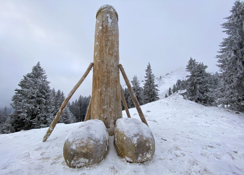 EDS NOTE GRAPHIC CONTENT - A wooden phallus sculpture about two meters high stands on the Gruenten mountain, Rettneberg, Germany, Thursday, Dec. 3, 2020. After the mysterious disappearance of the wooden penis, unknown persons have now created a replacement. On the 1738 meter high Gruenten in the Allgaeuer Alps, there is again a new phallus sculpture, supported by several beams. (Davor Knappmayer/dpa via AP)
